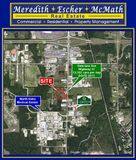 Approx. 5 acres 1/4 mile north of North Oaks Medical Center